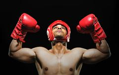 Male boxer with arms over his head Stock Photos