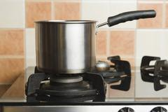 Close-up of a saucepan on a stove - stock photo