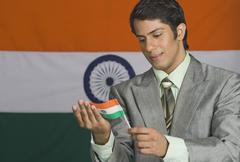 Stock Photo of Close-up of a man holding an Indian flag