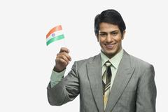 Portrait of a man holding Indian flag - stock photo