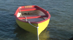 Empty little yellow-red boat in sea, Italy, Sicily. Stock Footage