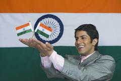 Close-up of a man holding Indian flags - stock photo