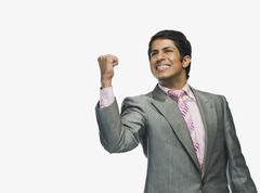 Businessman clenching fist in excitement Stock Photos