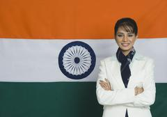 Portrait of a woman in front of an Indian flag Stock Photos