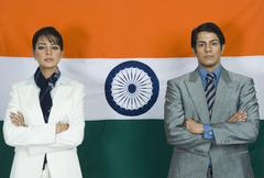 Business executives in front of an Indian flag - stock photo