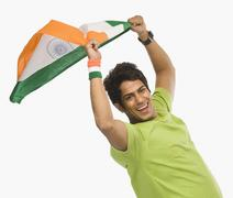Portrait of a man holding Indian flag Stock Photos