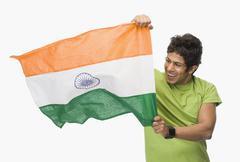 Close-up of a man holding an Indian flag Stock Photos
