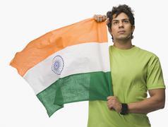 Man holding an Indian flag Stock Photos