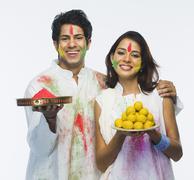 Stock Photo of Couple celebrating Holi