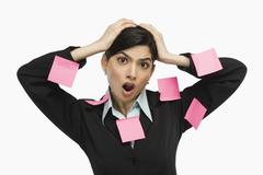 Adhesive notes on businesswoman's dress - stock photo