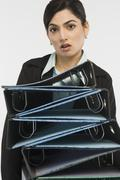 Businesswoman holding stack of binders Stock Photos