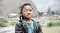 Cheerful cute girl in Himalayan village - stock footage