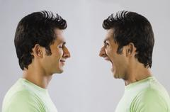 Digital composite image of a man yelling at self Stock Photos