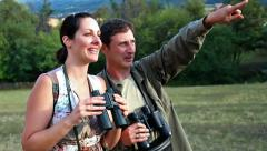 With binoculars in nature Stock Footage