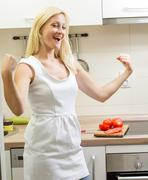 beauty woman in the kitchen - stock photo