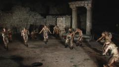 Barbarian warriors dance on the ruins of an antique theater Stock Footage