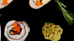 Different types of maki rolls on black Stock Footage