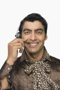 Portrait of a male customer care representative wearing a headset Stock Photos