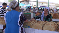 Buying bread at Uzbekistan bazaar Stock Footage