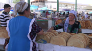 Stock Video Footage of Buying bread at Uzbekistan bazaar