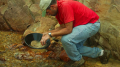 Gold panning prospector prospect 1 Stock Footage