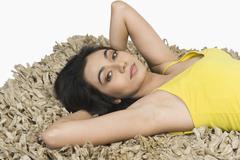 Woman lying on a rug - stock photo