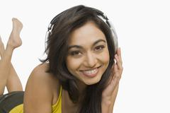Stock Photo of Portrait of a woman listening to headphones