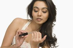 Woman filing her fingernails - stock photo