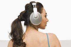 Woman listening to headphones - stock photo