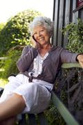 Happy senior woman talking on mobile phone Stock Photos