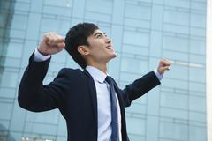 Young Businessman with fists in the air Stock Photos
