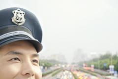 Police officer, half face, portrait Stock Photos