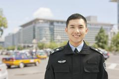 Police Officer Smiling, Portrait, China Stock Photos