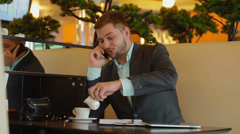 Young, attractive businessman talking on the phone Stock Footage