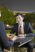 Business People Working While Having Dinner - stock photo