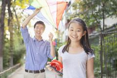 Father and Daughter Flying a Kite - stock photo