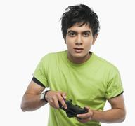 Portrait of a man playing video game - stock photo