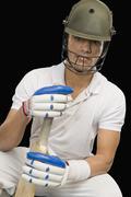 Portrait of a cricket batsman with a cricket bat Stock Photos