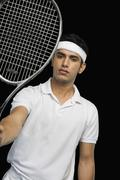Tennis player showing a tennis racket Stock Photos