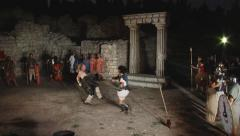 Battle of gladiators in ancient theater in the ancient ruins Stock Footage