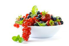 Bowl with berries Stock Photos