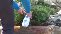 Man filling a plastic bottle, mountain spring water, spout, drinking water Stock Footage
