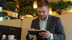 Young businessman looking at the camera and smiling - stock footage