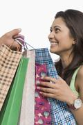 Close-up of a woman holding shopping bags - stock photo