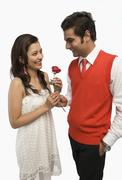 Stock Photo of Man giving a rose to his girlfriend