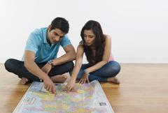 Couple examining a map - stock photo
