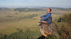 Healthy young man practice youga in height mountain at early morning and sunrise Stock Footage