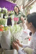 Two Mature women Looking At Flowers In Flower Shop Stock Photos