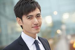 Close-up portrait of confident young businessman, China - stock photo