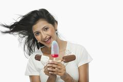 Stock Photo of Woman holding ice creams and laughing